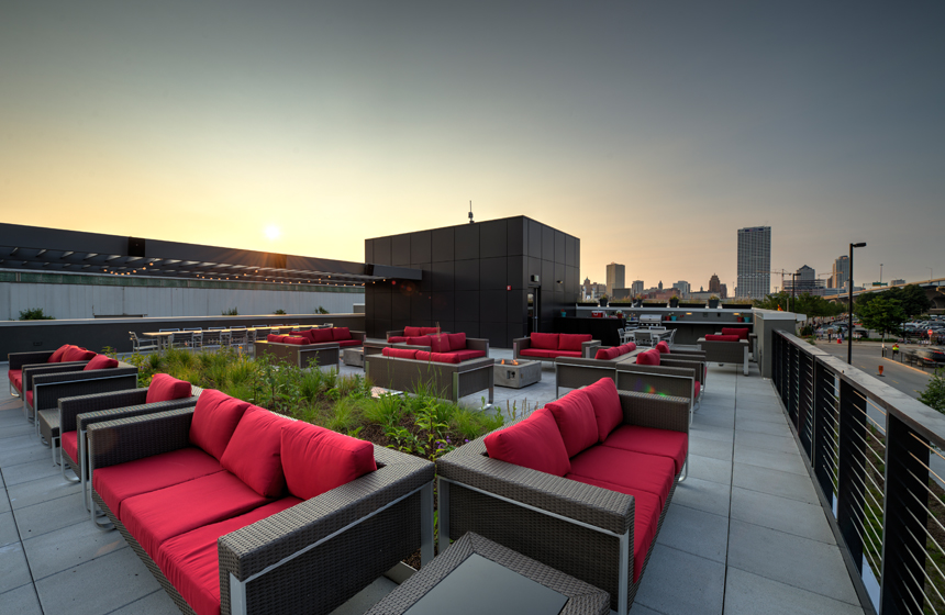 view of outside area with red couches and Milwaukee skyline in background