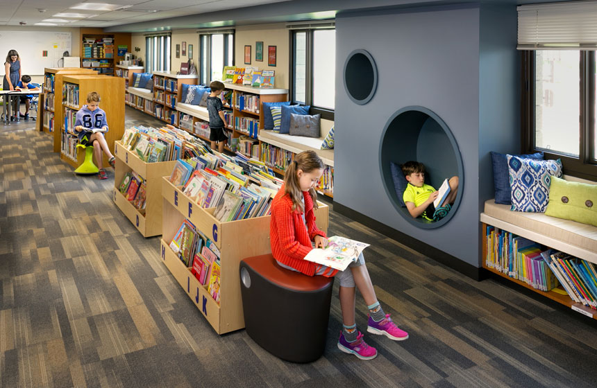 view of books and children reading in the fun and modern spaces