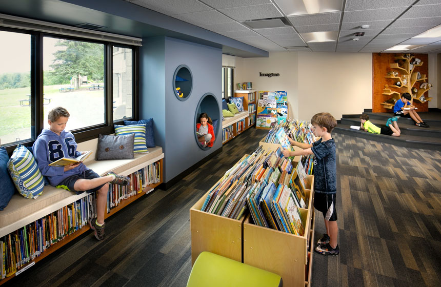 view of kids reading and looking at the books in the library