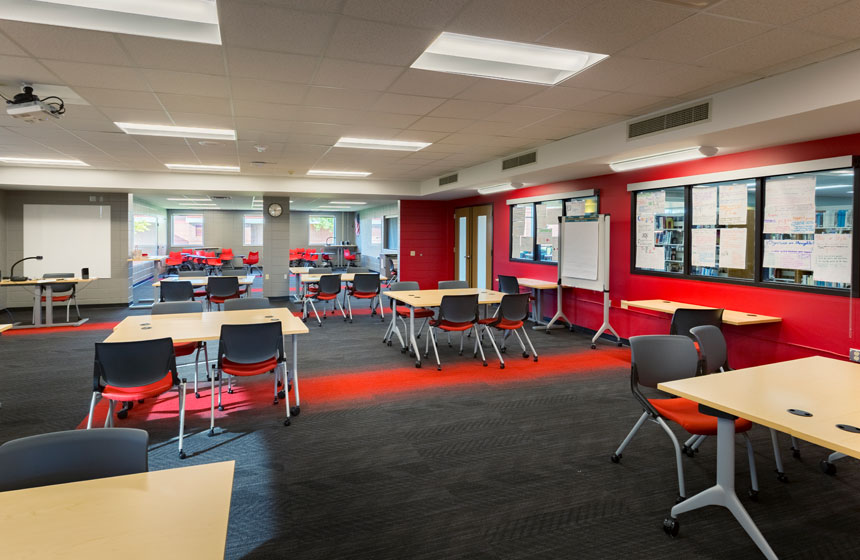 view of study space with tables and chairs for groups