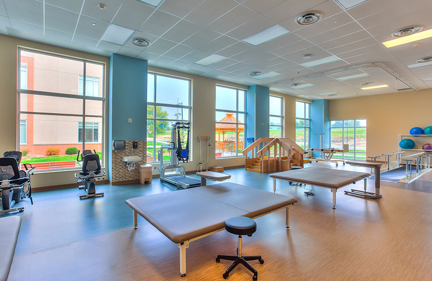 Rehab center with exercise machines and tables
