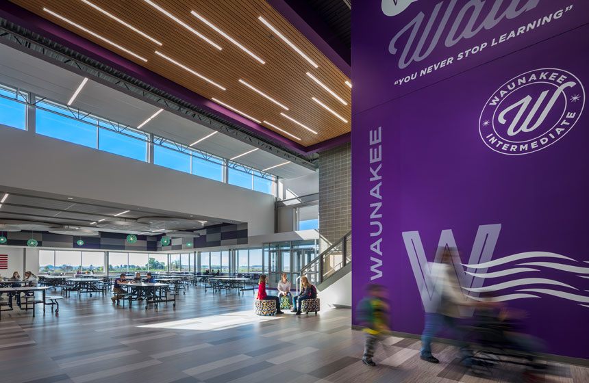 cafeteria with purple waunakee intermediate school logo