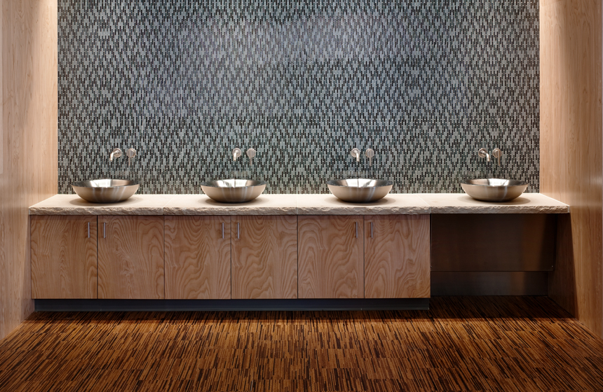 Four sinks with tile backdrop