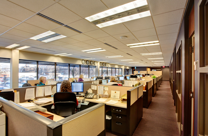 view of desks with employees