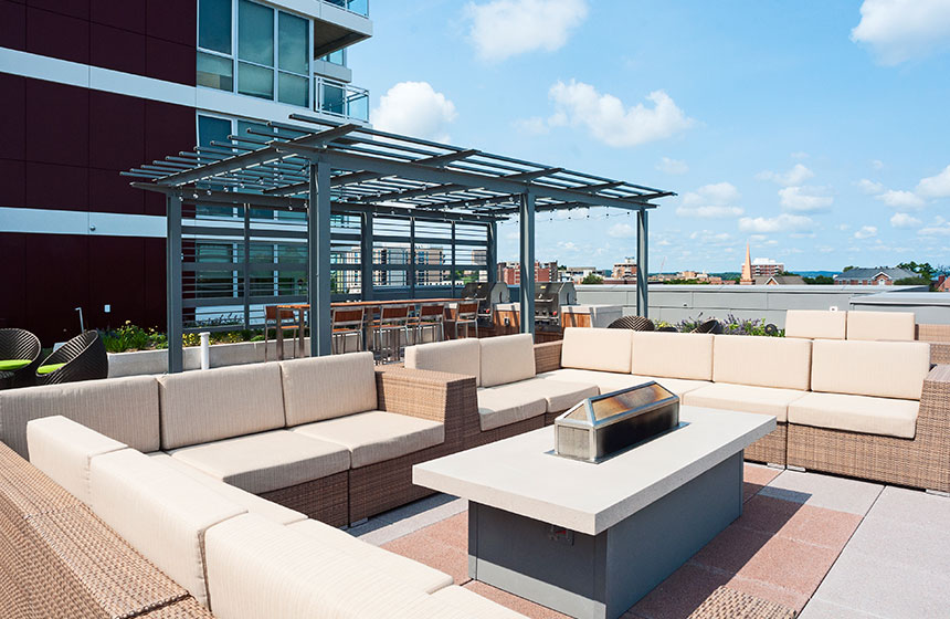 Rooftop patio with couches and table