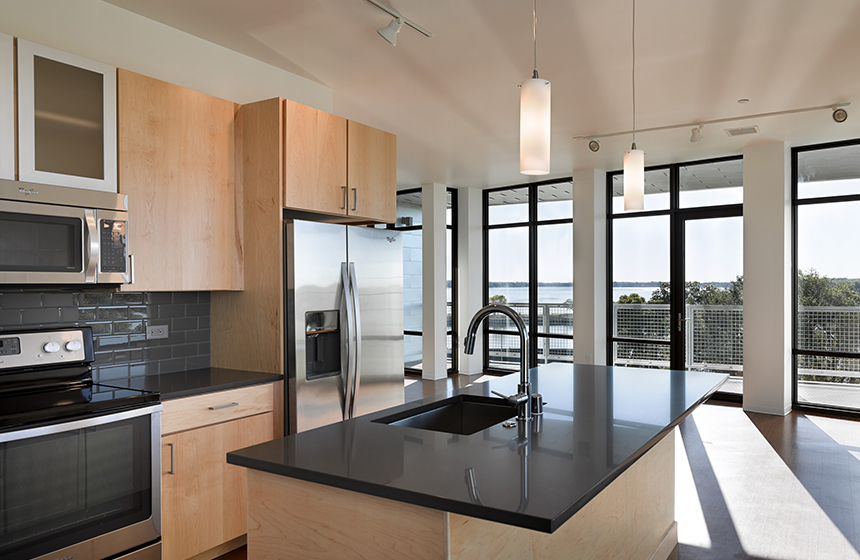 Kitchen with floor to ceiling windows