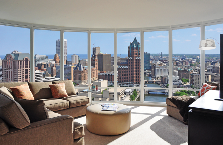 Living room with big windows, view of city